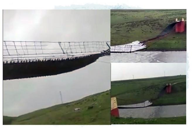 Akyaka'daki 110 metrelik asma köprü şiddetli rüzgardan parçalandı